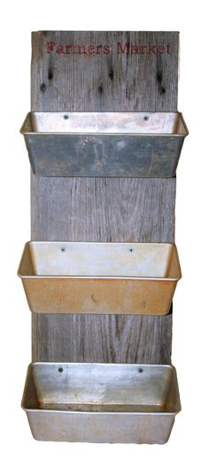 Repurposed loaf pans and barn wood make great hanging produce storage.