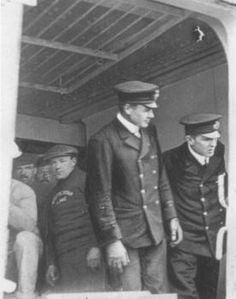 Historic photograph of 2nd Officer Lightoller and 1st Officer Murdoch seen through Titanic's open starboard E-Deck door forward