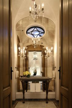 Small but fabulous, mirror in arch wow.  Think that window goes to powder room?