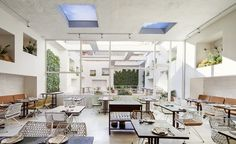 Natural lighting in a restaurant can make all the difference! Love how this space maximizes lighting through skylights.