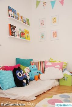 Reading corner - pillows on the floor! love it but needs a READ pillow