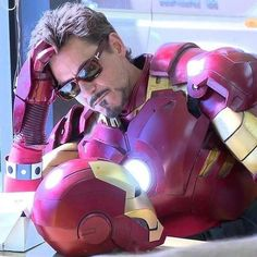 "Robert Downey Jr. - behind the scenes, ""Iron Man 2.""  You can see the mo-cap dots on his right arm (where parts of the armor will be CGI'ed in later)."