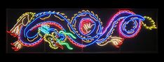 4'x16' custom neon dragon built by my good friend, hanging in tattoo parlor. great, great piece. awesome when you are standing in front it at eye level.