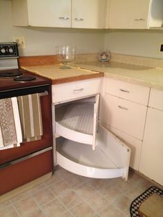 large shelves swing out from the back corner = one option for the kitchen cabinets