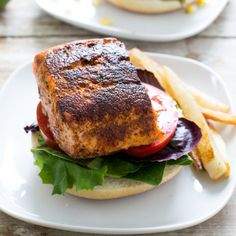 Blackened Salmon Sandwich with a Sweet and Smokey Grilled Corn Salsa. Super easy to make and loaded with tons of flavor.