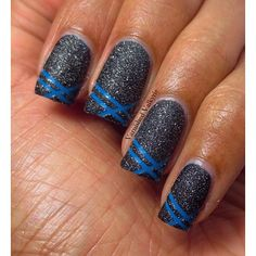 Awesome French tips!!!  Bright blue laser line tips against a black, sparkly, textured polish!!!