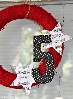 Super wreath, foam core wrapped in burlap, attach a paper mache number covered in scrapbook paper