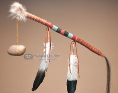 This is a very unique Native American tomahawk war club. This is an actual Native club made by the Tigua Indians. This decorative tomahawk war club is decorated with hand bead work, prayer feathers an