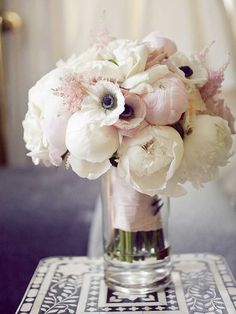 A gorgeous symbol of happiness and prosperity, peonies have long been a popular wedding flower. With hues ranging from soft and pretty to bright and seductive, just a few of these romantic ruffles added to a centerpiece or/