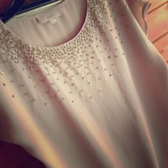 Stunning  LOFT  Nude Blouse Such a pretty blouse!!  In excellent condition, just worn once.  Embellished with just the right amount of gold colored sequins. So pretty on the beige background.  Has a gathered bottom so can be worn where it's comfortable.  Has a slight dolman short sleeve.  Gorgeous top! Sz M.  Please let me know if measurements are needed. LOFT Tops Blouses