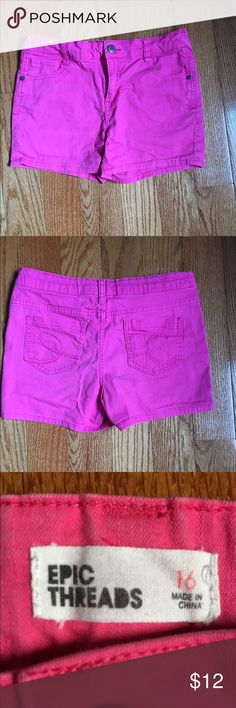 All pink denim material shorts These shorts are all pink and feel like denim material. Size 16. These do have back and front pockets. On the inside of the shorts they have buttons so u can tighten the shorts on the hips. Bottoms Shorts