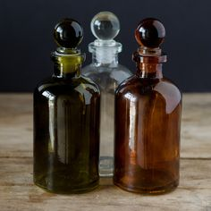 Made of recycled glass, this unique 8 ounces bottle comes with a matching glass top. Available in clear, amber and vintage green. Please note that the color (Vintage Bottle) Apothecary Bottles, Antique Bottles, Vintage Bottles, Bottles And Jars, Mason Jars, Perfume Bottles, Bottle Candles, Vintage Perfume, Antique Glass