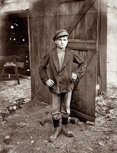 A Glass Works Boy waiting for the night shift. Indiana Glass Works. August 1908 / Photograph by Lewis Wickes Hine