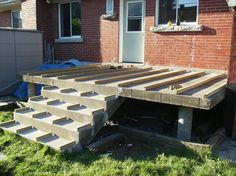 a Wooden Deck Over a Concrete One Pick out your deck plans then visit McCoy's Building Supply for lumber, stain, deck screws and more. Pick out your deck plans then visit McCoy's Building Supply for lumber, stain, deck screws and more. Deck Over Concrete, Concrete Front Porch, Concrete Steps, Front Porch Deck, Front Porch Remodel, Small Front Porches, Concrete Building, Stamped Concrete, Deck Building Plans