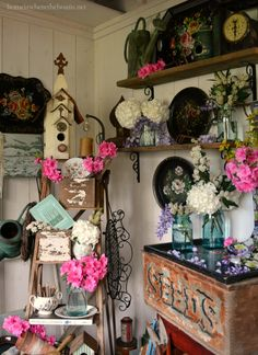 In the Potting Shed: Ladder and shelves planted with tole trays and flowers | homeiswheretheboatis.net #garden #spring