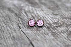 Antique bronze stud earrings with black dots on pink