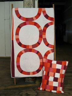 I'm going with a similar color scheme for my Single Girl quilt, all reds against snowy-white back fabric.