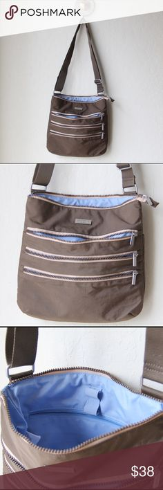 """Baggallini Crossbody Bag Super functional bag! L 11"""" x H 10"""" x W .5"""" strap is 26"""" and can be extended 2X that. Color is dark brown with 3 zipper pocket one side, one large pocket in the other, a zipper pocket on the inside, key chain and 2 pen elastic holders Baggallini Bags Crossbody Bags"""