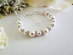 """Swarovski Pearl & Crystal #BridalBracelet by #DebraAnnCreations This Custom, Handmade Swarovski pearl and crystal bracelet is comprised of Swarovski Crystallized Pearls (white shown) that are enveloped in shimmering silver plated Crystal Rondelle Spacers and silver plated round beads. Has he option of a 1"""" chain extender with a pearl drop or a light blue crystal drop. That """"something blue"""" for the bride. It also has matching earrings & necklaces in the shop. #weddingbracelet #weddingjewelry"""
