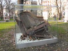 The instalation called Fallen Piano was inspired by Cyprian Kamil Norwid's poem entitled Chopin's Piano. It was created by Aleksander Janicki and placed near Slowacki Theatre in Cracow.