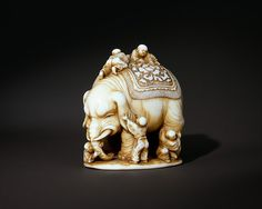 Blind Men and the Elephant Period: Meiji period (1868–1912) Date: 19th century Culture: Japan Medium: Ivory Dimensions: H. 1 5/8 in. (4.1 cm); W. 1 3/4 in. (4.4 cm)