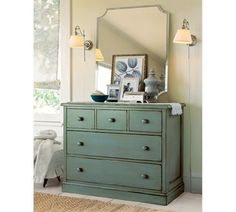 Love the robin's egg blue dresser and the reverse scalloped edge mirror, pendants, accessory styling.