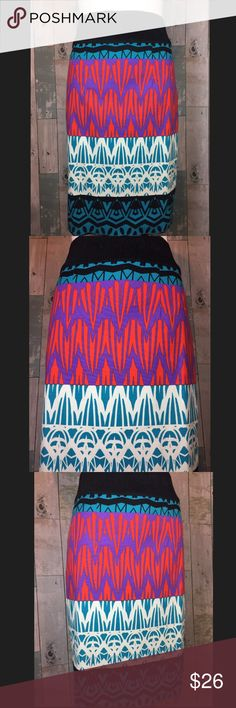 Plenty by Tracy Reese skirt Excellent condition!!! Skirt is 22 3/4 in length. Top 3 inches is elastic banding. Zippers down 8.5 inches in back middle. Slit at back middle is 6.5 inches.. Smoke free and pet free home!! Anthropologie Skirts Midi