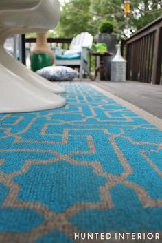 DIY stenciled (outdoor) sisal rug, I think it would be great for high traffic indoor areas too...