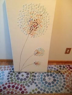 Dandelion art inspired by several Pinterest pins. Large canvas painted with left over wall paint. Painted stems with brown acrylic paint than hot glued flat glass mosaic marbles.