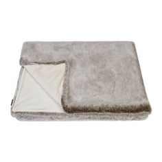 Create a cosy setting with this Siberian Wolf faux fur throw from Helen Moore. Wonderfully soft to the touch, it is available in a range of natural finishes and is enhanced with faux suede lining. Per