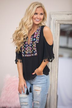 From vacation days to nights in the backyard, this gorgeous cold shoulder blouse is perfect for any summer celebrations! You can't go wrong with the lightweight and slightly textured black material -