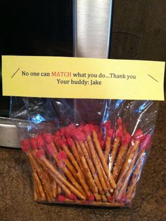 Matches for a fireman gift basket, pretzel rods dipped in red chocolate with yellow and orange sprinkles