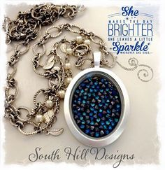 Silver vintage oval locket with aruba blue embellishment-- like carrying a piece of the sky in your locket.