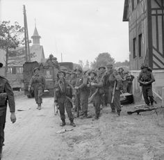 BRITISH ARMY NORMANDY 1944 (B 5039)   Men of 2nd Royal Ulster Rifles pause during the move inland from Sword Beach, 6 June 1944.