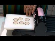 video on how easy it is to flatten bottlecaps with a Big Shot or Cuttlebug.