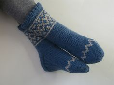 These are simple, cuff-down socks, with a small stranded line and a picot edge.