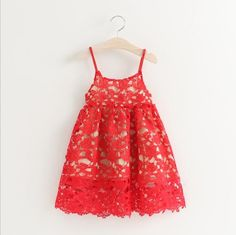The beautiful Avery Dress features a stunning red embroidery over a sheer nude slip.  With spaghetti straps and a lovely full skirt- this dress is sure to be a