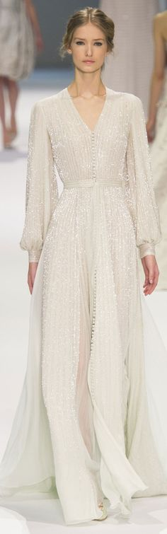 Ralph & Russo Couture Spring 2015. This dress reminds me of something from Jane Austen's era. And for that I love it even more. The simplicity and charm this dress carries is wonderful.