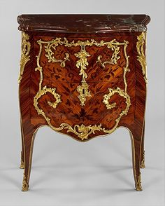 Commode Roger Vandercruse called Lacroix (French, 1728–1799) Date: ca. 1755–60 Culture: French (Paris) Medium: Oak veneered with tulip-, rose-, and end cut kingwood, gilt bronze and rouge griotte marble