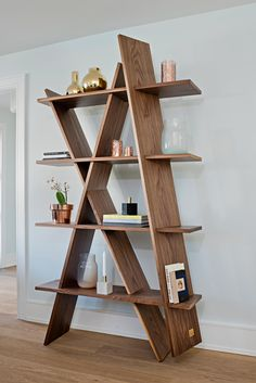 Showcase both books and your favourite decor items on this statement bookcase.  We show it with stunning glass vases from the Czech Republic, marble candlesticks from Denmark and beautiful brass and copper accessories from Sweden.