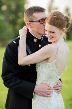 Marine kisses his new bride on the cheek as she smiles | www.hannahandrandall.com