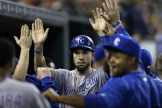 Kansas City Royals' Eric Hosmer is greeted in the dugout after scoring on a single by teammate Alex Gordon during the seventh inning of a baseball game against the Detroit Tigers, Friday, May 8, 2015, in Detroit.