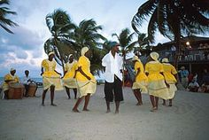 The people of Belize dancing together.
