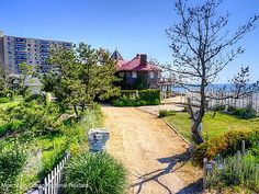 35 Ocean Ave, Monmouth Beach, NJ 07750 | MLS #22130740 | Zillow Monmouth Beach, Stanford White, Ocean Front Property, Buses And Trains, Historic Architecture, Once In A Lifetime, The Hamptons, Acre, Sunrise