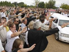 Supporters of Eugene Terreblanche salute his coffin as it is driven from the church in Ventersdorp, South Africa