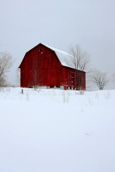 Red barns and snow covered hillsides