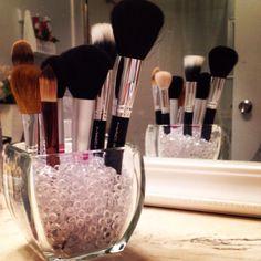 Keeping makeup brushes organized.