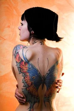 Amazing detail on this full color backpiece butterfly tattoo