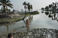 Facing Rising Seas, Bangladesh Confronts the Consequences of Climate Change -Borrowed Time on Disappearing Land - When a powerful storm destroyed her riverside home in 2009, Jahanara Khatun lost more than the modest roof over her head. In the aftermath, her husband died and she became so destitute that she sold her son and daughter into bonded servitude.