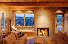 traditional living room with brown sofa granite table window seat cushions hardwood flooring and fireplace Rammed Earth Homes, Rammed Earth Wall, Sustainable Architecture, Architecture Design, Earth Bag Homes, Earthy Home, Adobe, Tadelakt, Earth Design